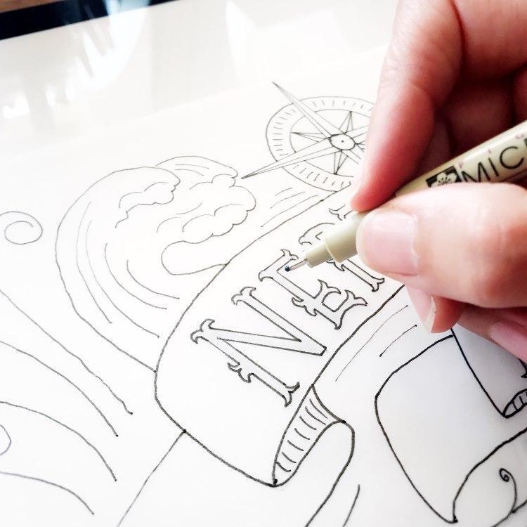 Detailaufnahme Lettering mit Hand und Stift
