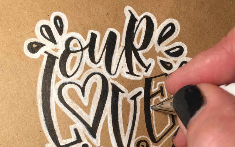 our love - effektvolles schwarz-weiss Lettering Titelbild