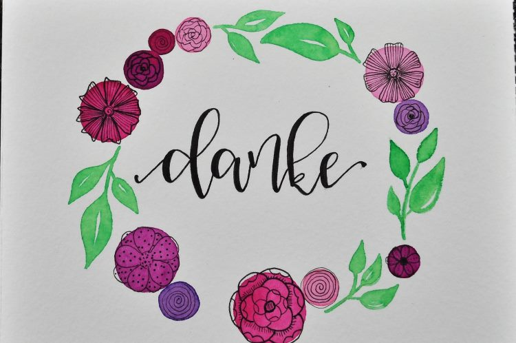 danke - Handlettering mit einem Blumenkranz