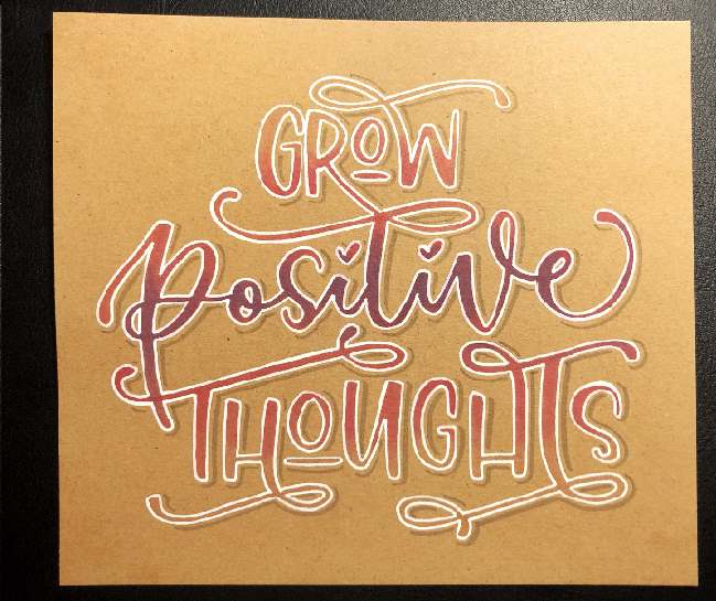 buntes Handlettering auf Kraftpapier: grow positive thoughts