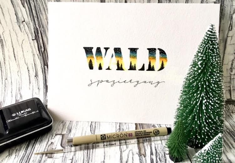 Wald-Spaziergang - Lettering mit einer Illustration in den Buchstaben