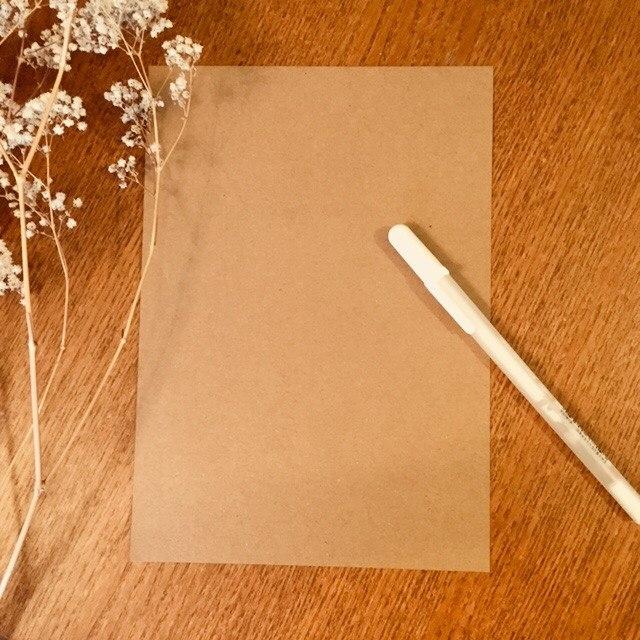 Kraftpapier mit weissem Schreiber - Material für eine Musikmeditation mit Lettering