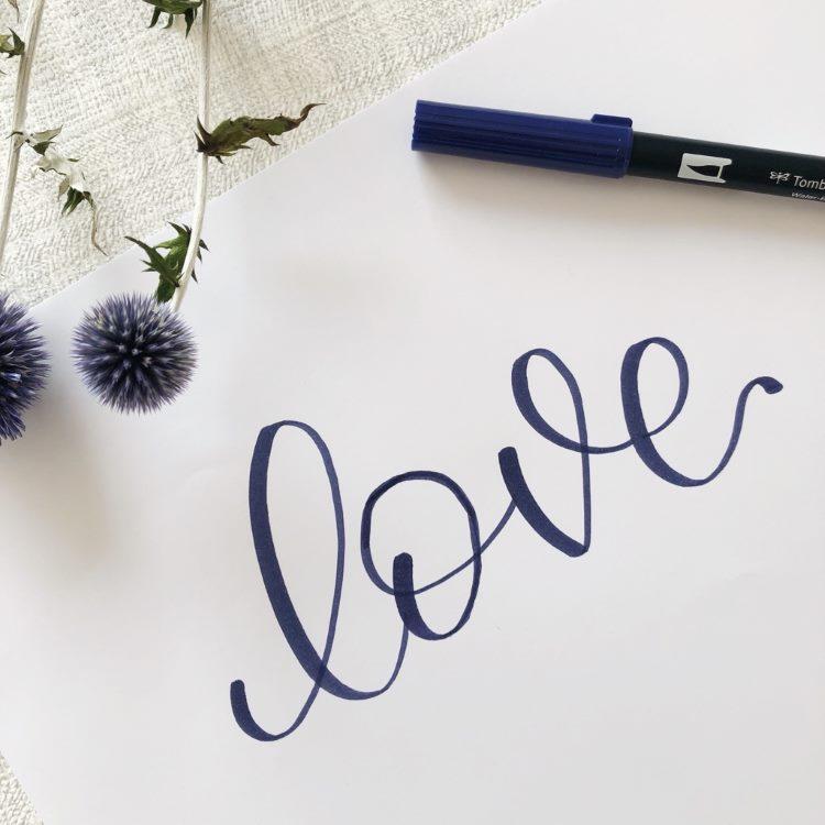 love - Brushlettering in dunkelblau