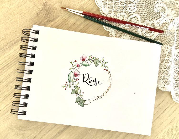Rose als Lettering mit einem Blumenkranz