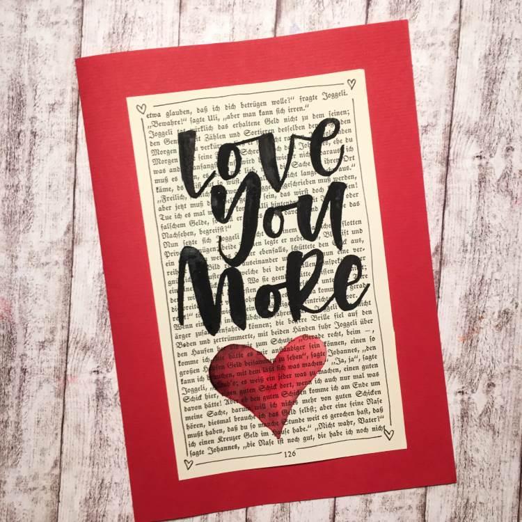 love you more - Handlettering auf einer alten Buchsteite