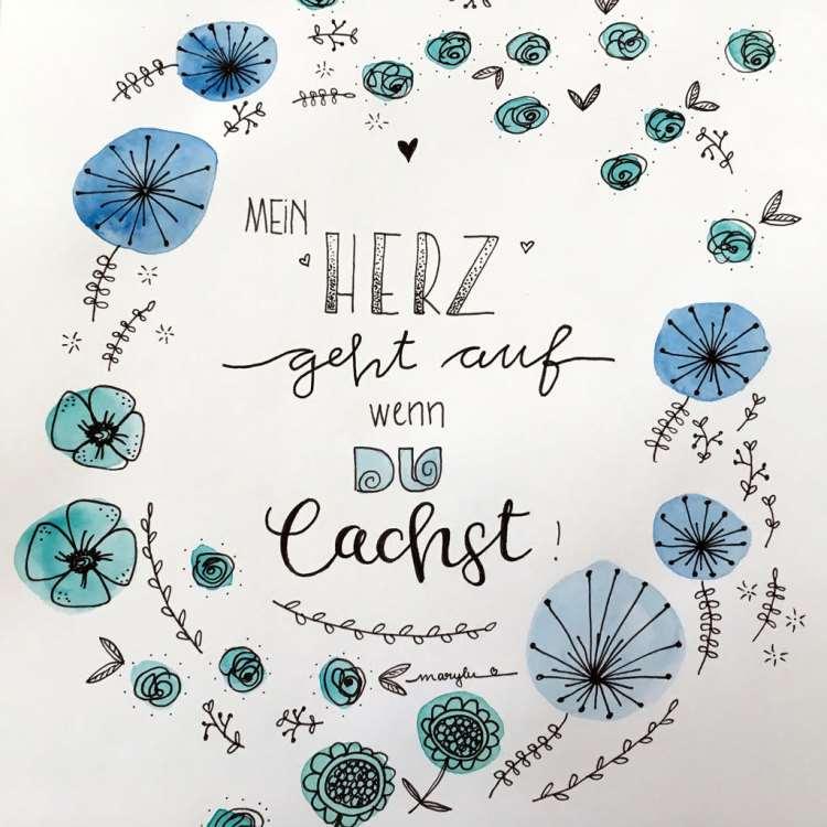 Handlettering mit Blumen in einem Kranz drumherum - mein Herz geht auf wenn du lachst