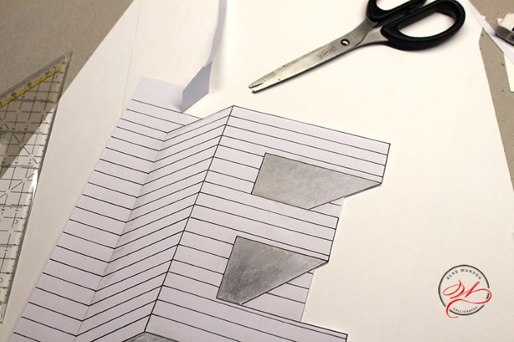 optische Illusion vom Buchstaben E gestalten - schneiden