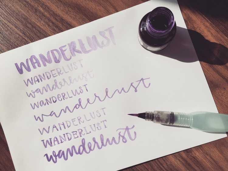 wanderlust - Wort in verschiedenen Lettering Stilen gelettert