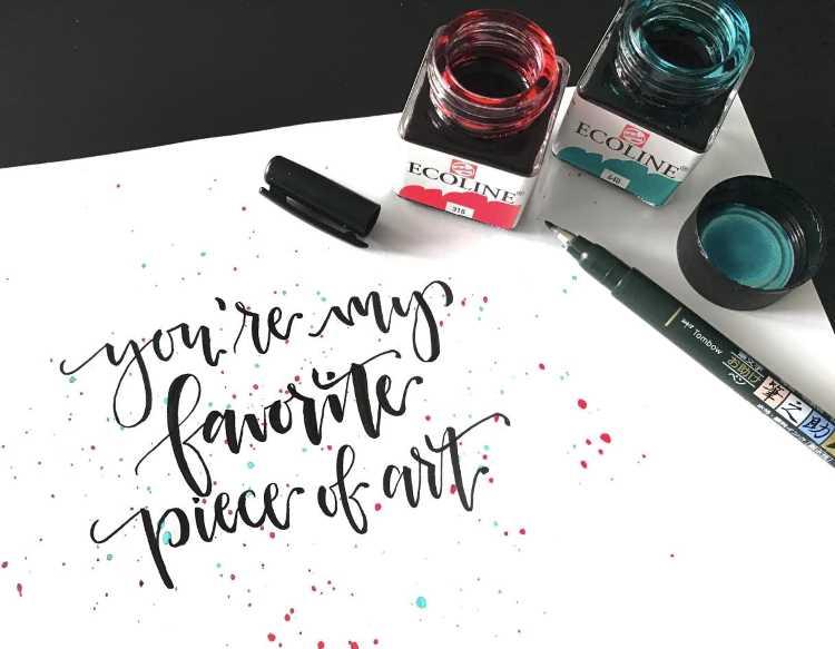 Brushlettering in Schwarz mit farbigen Sprenklern - you're my favorite piece of art
