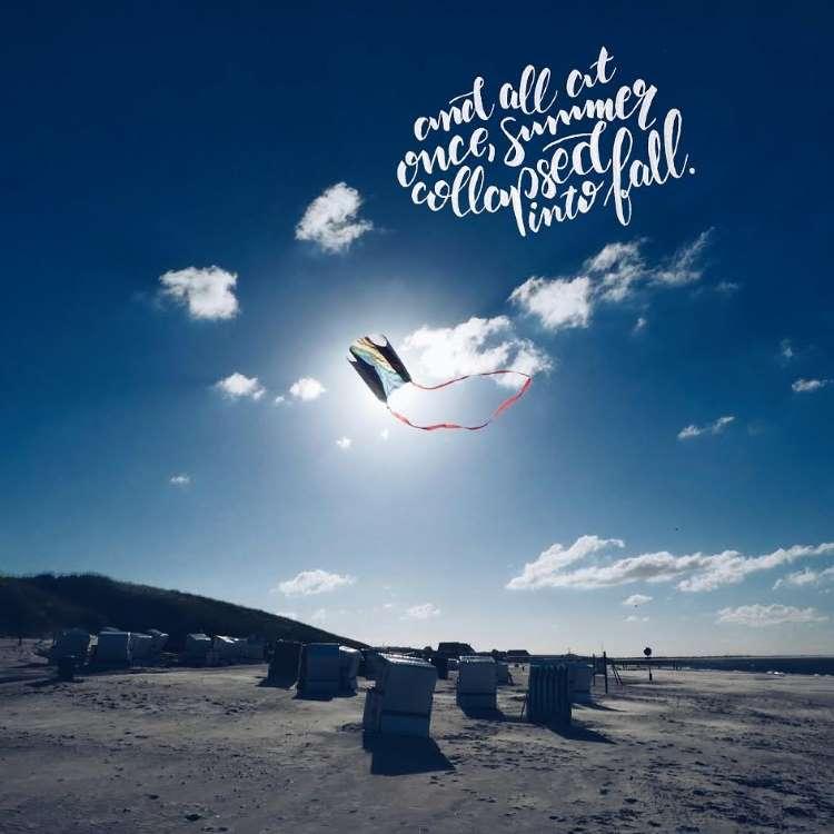 Handlettering Spruch auf einem Foto mit einem Drachen am Himmel
