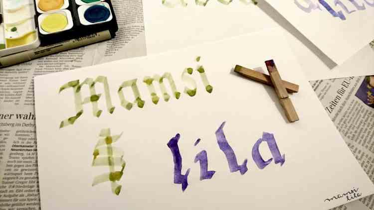 Kalligrafie mit Wäscheklammern