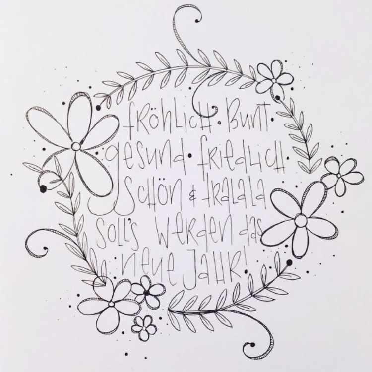 Handlettering mit schwarzem Fineliner und einem Blumenkranz