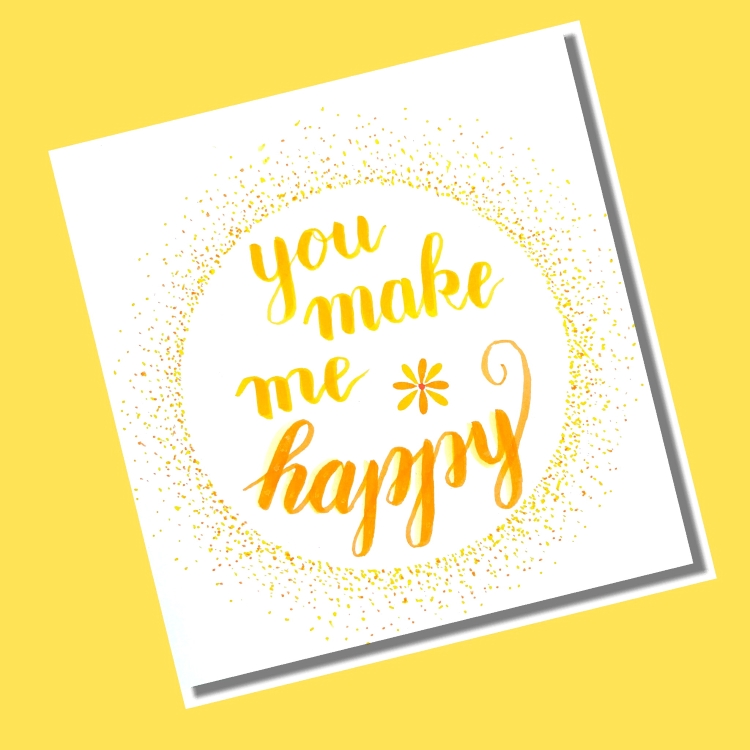handlettering in einem Kreis aus Punkten - you make me happy