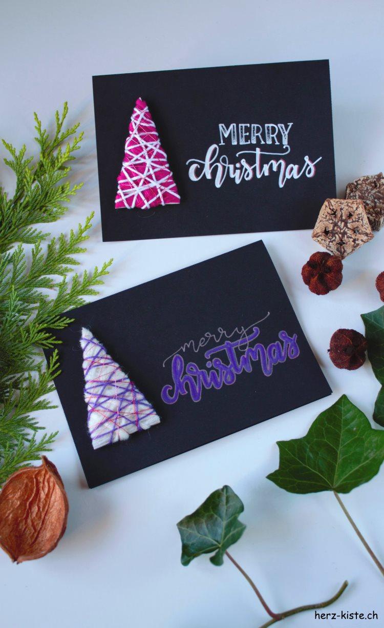 schwarze Weihnachtskarten mit Handlettering und Tannenbäumen aus Wollresten