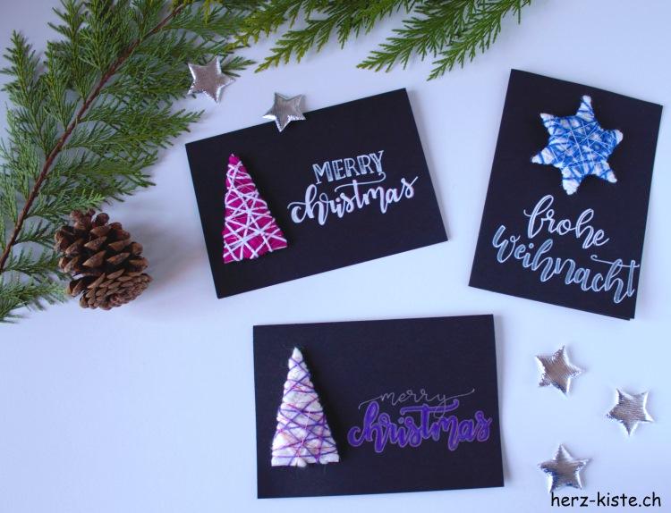 Weihnachtskarten mit Handlettering und Wollresten als Tannenbaum und Stern