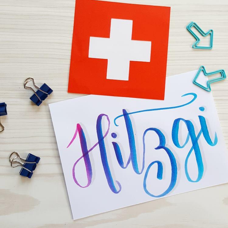 Hitzgi: Schluckauf - schweizerdeutsches Dialektwort in Brushlettering